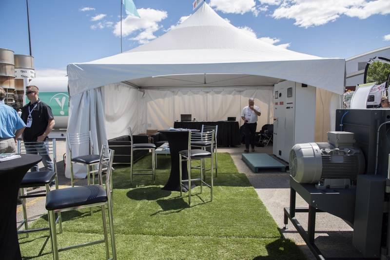 Outdoor furniture rental plus synthetic lawn on asphalt. - Event Rental Furniture From Superior Show Service