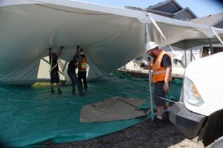 Installation of a rental pole tent for Habitat for Humanity in Fort Saskatchewan, Alberta