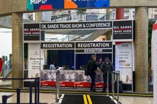 Custom graphics gives branding to registration desk at shows