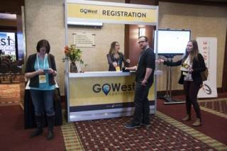 Registration counter with graphics at Go West Conference 2018