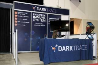 Dark Trace exhibit booth with custom graphics