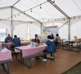 Clearspan event tent rental, decorated interior with flooring.