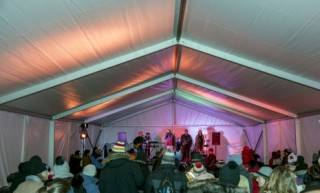 Clearspan event tent rental. Heated for winter festival, with stage