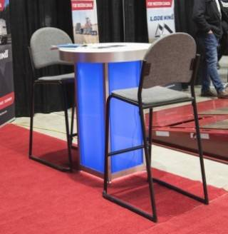 Event rental upholstered stools at charging station