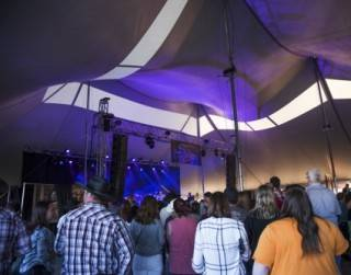 Festival tent rental for concert, with custom bars and VIP staging, Rainmaker Music Fest, St. Albert