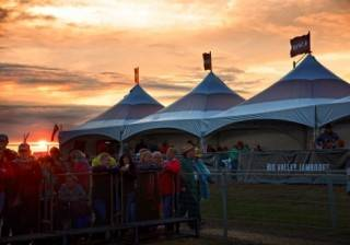 Festival VIP event tent rental at sunset