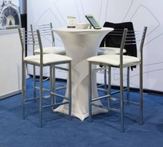 Event Rental decorated cruiser table in white spandex with with leather stools