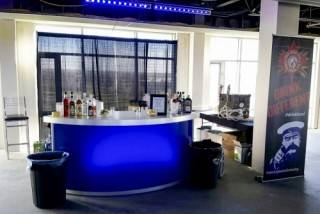 Rear-lit curved counter for event lounge and corporate event or festival