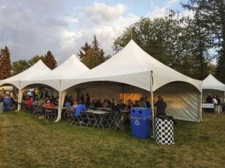 Outdoor furniture rentals for banquet seating in outdoor tent rental