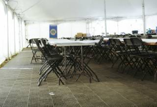 Outdoor furniture rentals and flooring for tent rental events