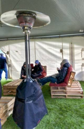 Outdoor furniture rentals with heated tent and custom pallet furniture
