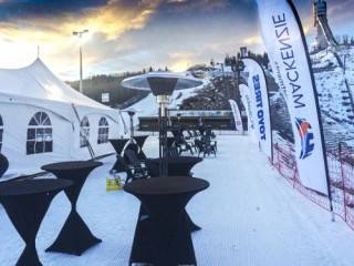 Winter rated sporting tent rental at Canada Olympic Park, Calgary, with propane heater and cruiser tables.