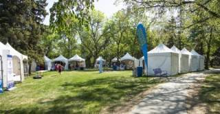 Frame tent rentals grouped in vendor village at UFest, Edmonton
