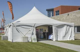 Event tent rental with cement blocks