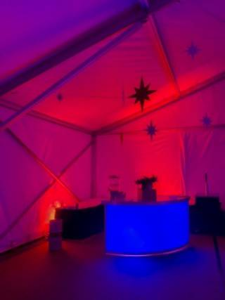 Wall wash lighting effect with back lit custom bar for tent rentals
