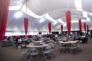 Event tent rental for Festival pole tent with tables, chairs, stage, bar & buffet at Big Valley Jamboree, Camrose