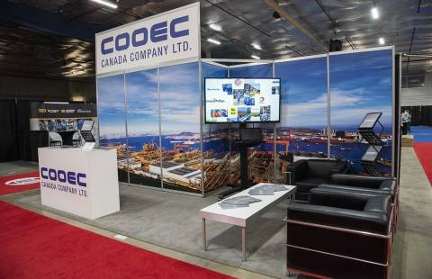 trade show booth with full graphics and TV